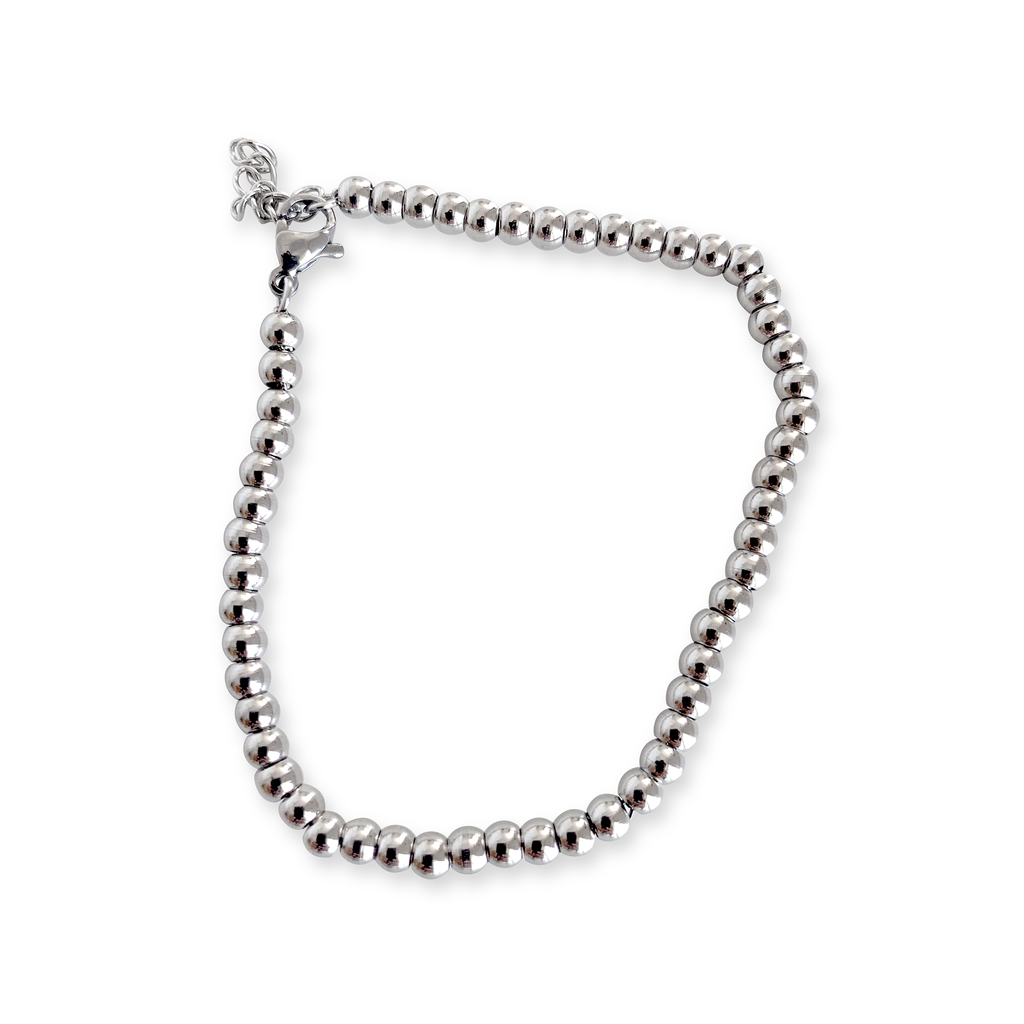 THE PUNTITOS Silver Small which is made of stainless steel silver circle beads.