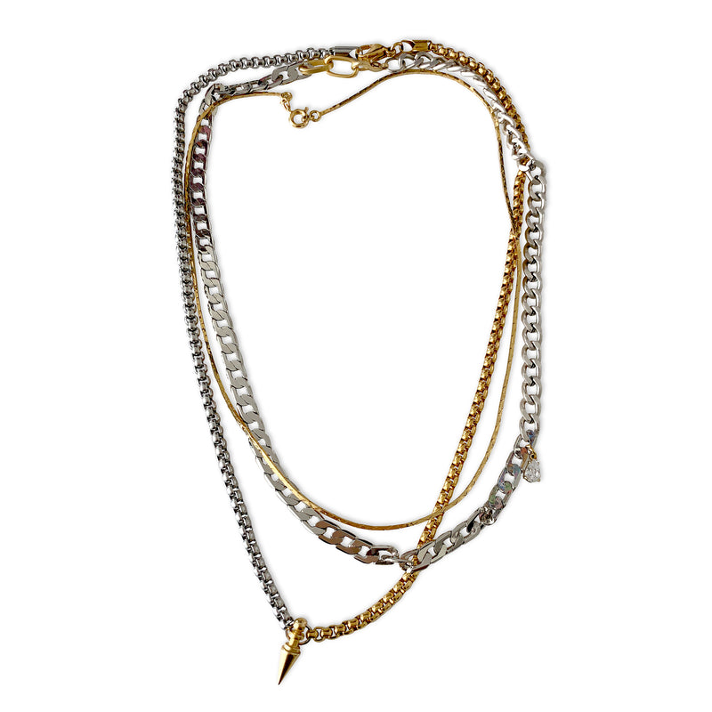 SPIKE TRIO SET which is a 3 chain layered set that comes in Thin Brass Gold Plated, Brass Link Chain Rhodium plated, Stainless Steel. Two necklaces come with the Chain Zirconia Drop Mini Pendant and Brass Gold Plated Spike Pendant.