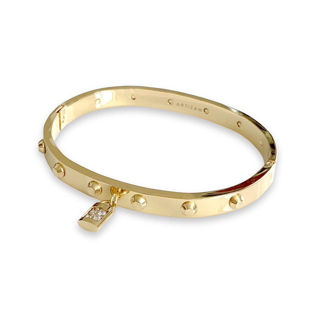 Lock bangle which is a gold bangle with a lock charm. it has few flat spikes around the bangle.