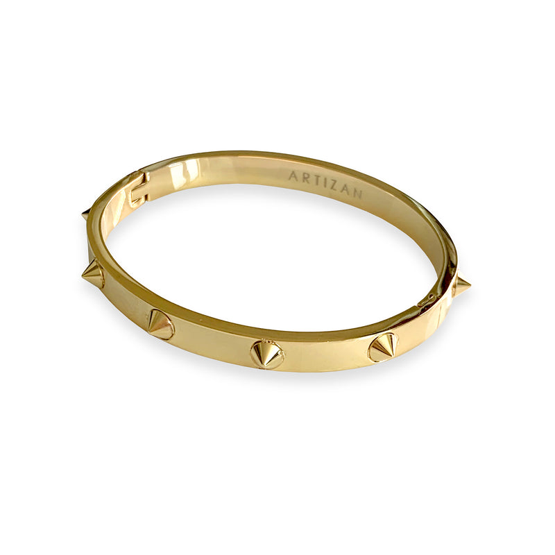 SPIKES BANGLE in gold plated stainless steel with spikes around it.