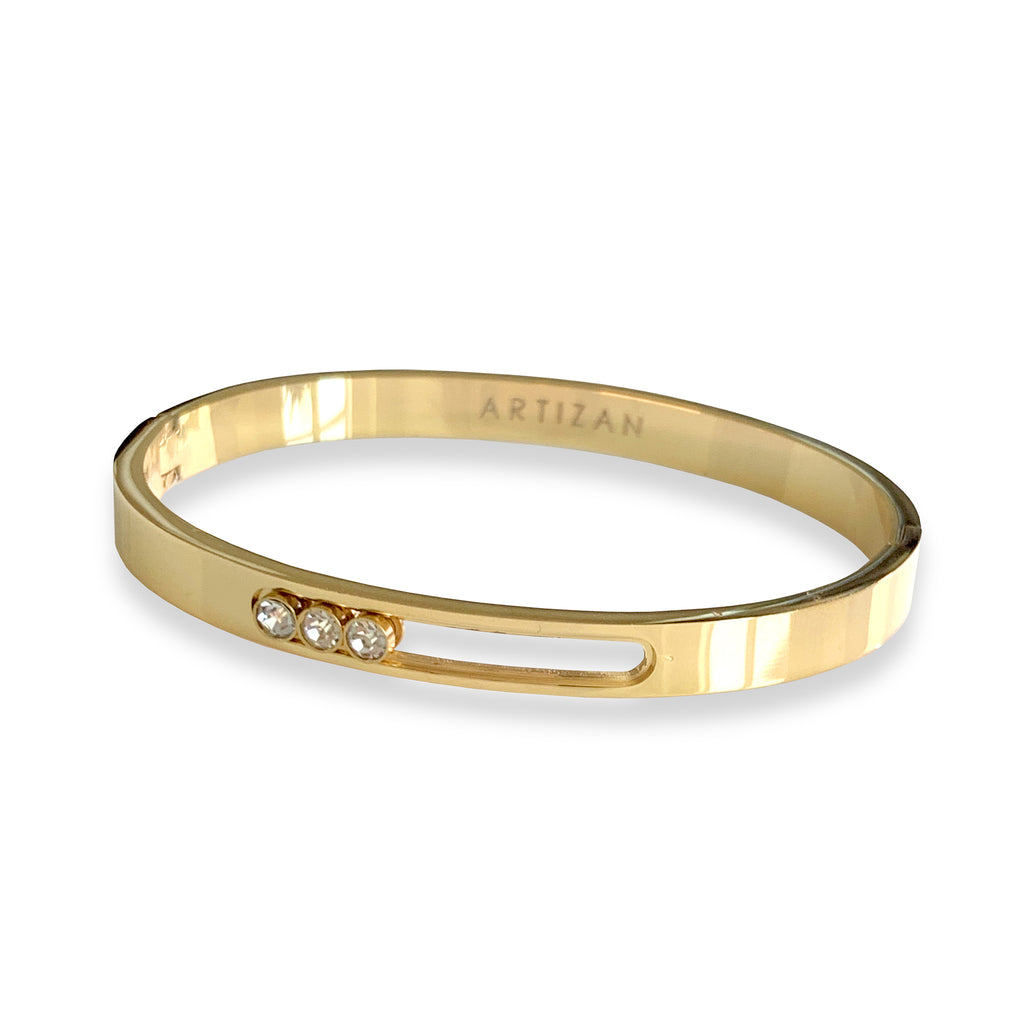 Moving bangle in Stainless steel Gold plated with three Cubic Zirconia.