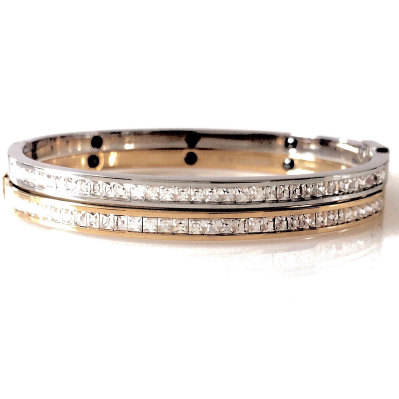 Two Shiny bangles in Gold plated, Rhodium plated stainless steel covered with Cubic Zirconia stones.