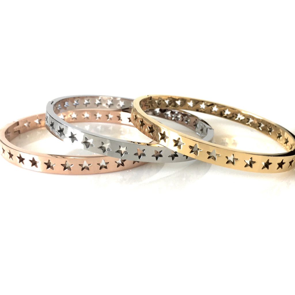Three Shooting Stars bangles in Gold plated, Rhodium plated, Rose Gold variants. It has cut out stars around them.