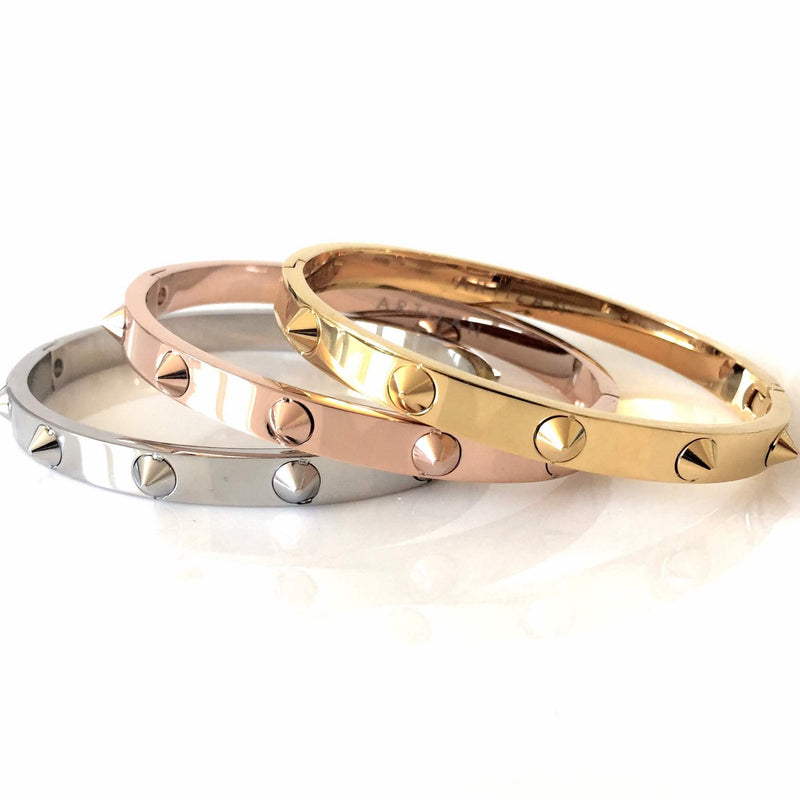 Three Spikes Bangles in Rose, Gold and Silver color with spikes around them.