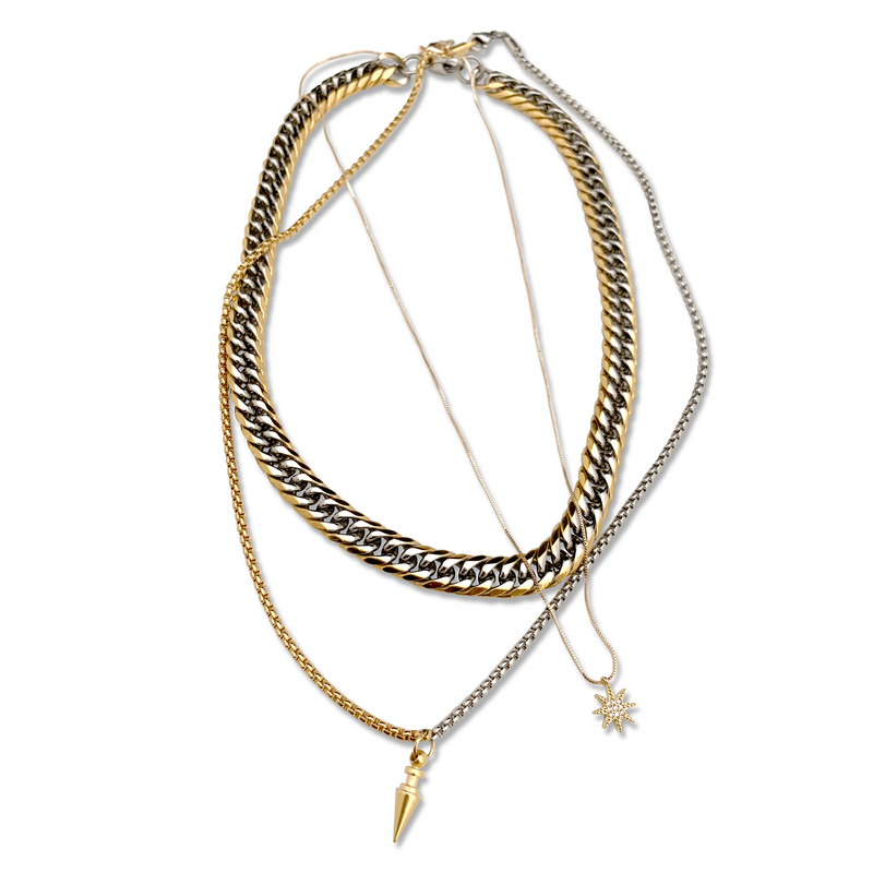 3 Chains Layered MIX SET which comes with the Mix chain necklace, thin gold plated chain with a Zirconia Sun Mini Pendant and a half gold and half silver longer chain with a Brass Gold Plated Spike.