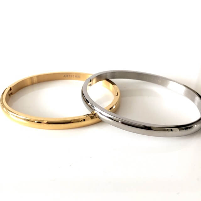 Two PLAIN BANGLE comes in Gold plated and Rhodium plated Stainless steel.