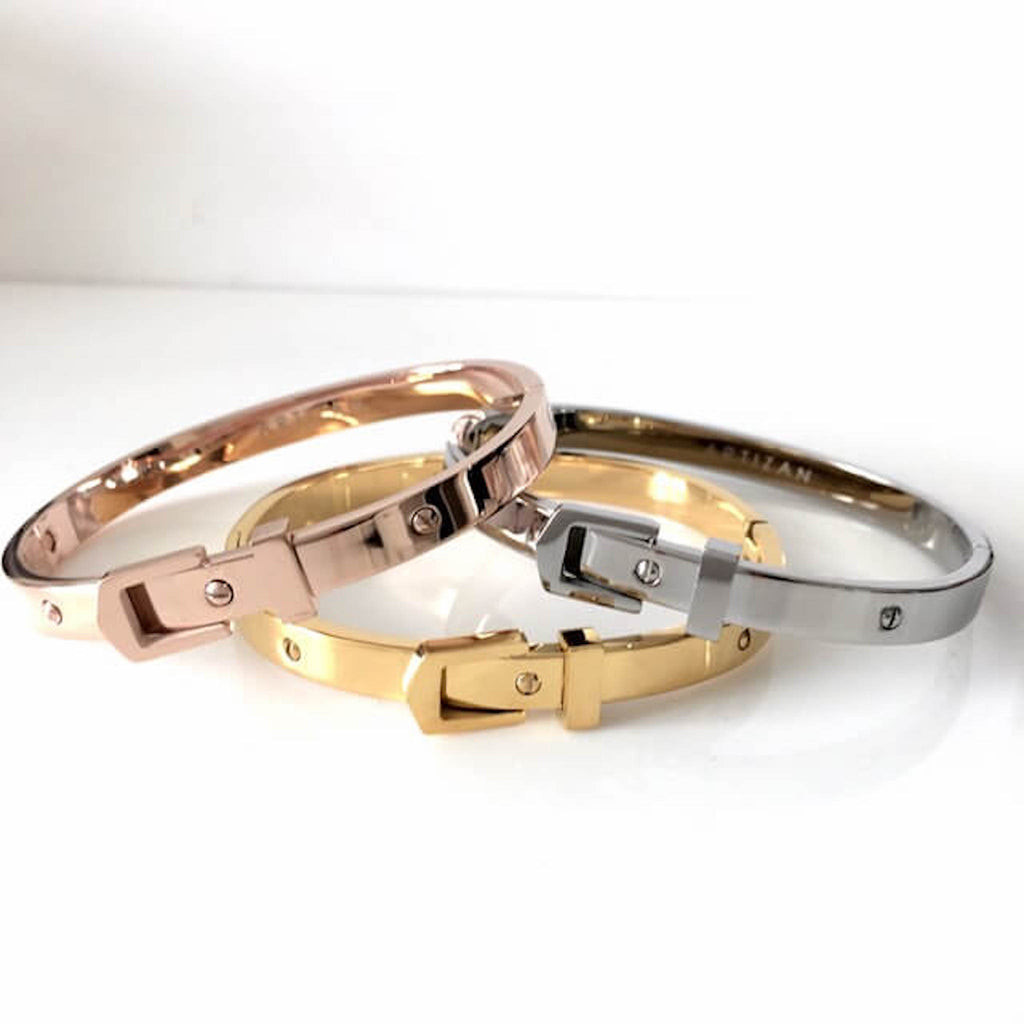 Belt Bangles stacked from Gold with belt buckle, followed by the silver with belt buckle and rose gold with belt buckle design on the top.