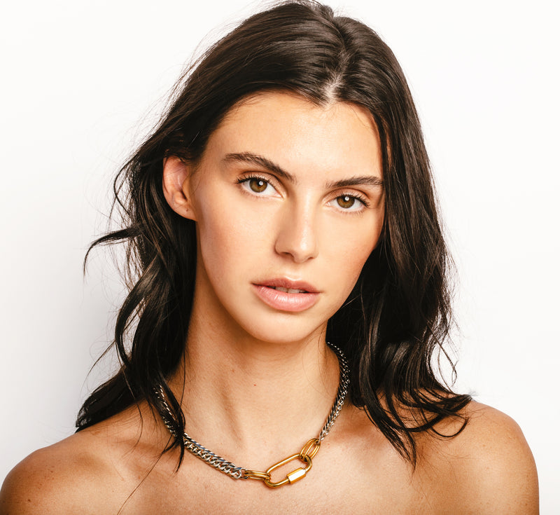 Model wearing the Anna silver chain necklace with big gold oval clasp.