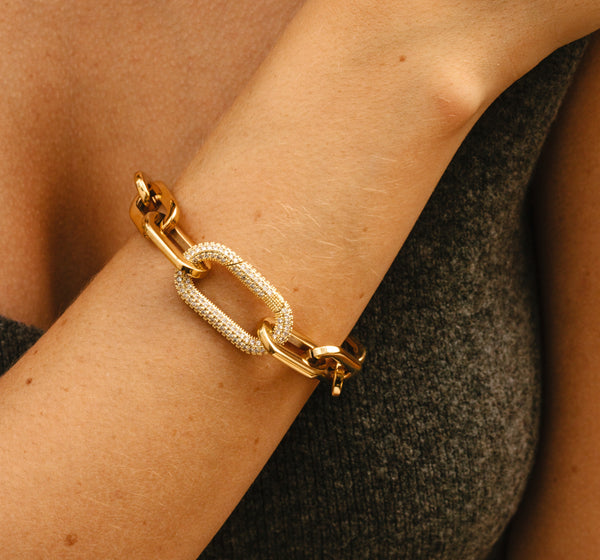 Model wearing the Puerto Fino Bracelet in gold plated stainless steel with a Micro Pave Zirconia lock.