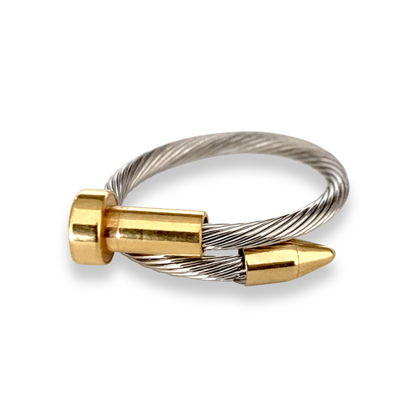 Clavo Wire ring in silver and with gold details on each ends. Design is similar to a nail with flat end and pointed end on another overlapping each other.