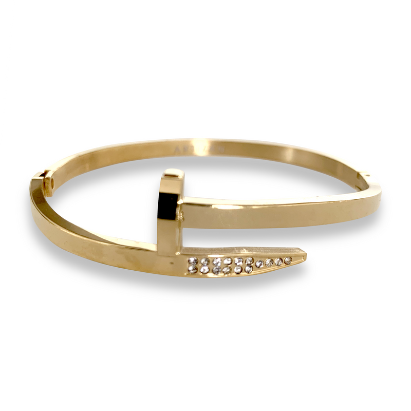 Clavo Shini in Gold color. The design is similar to a nail with sparkling stones in one end and flat surface on the other.
