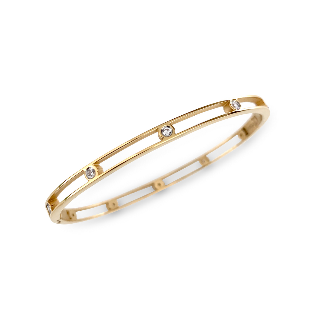 Air bangle which is 4mm wide, gold plated with 8 zirconia dots in the middle.
