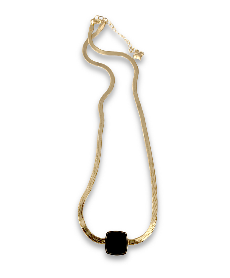 Snake Square Gold which is a gold plated stainless steel flat chain with black square enamel charm.