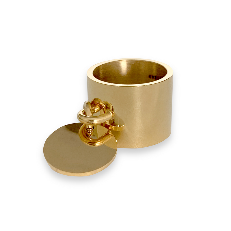 Coin Ring which is gold around one inch wide with a knob that has a coin charm hanging on it.