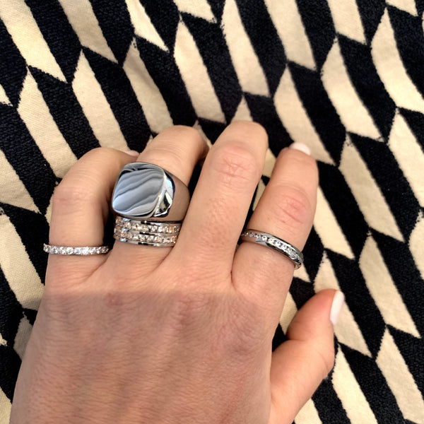 Model wearing the just ring, milky way ring, forever ring and the Square Zirconia doble ring all in silver.