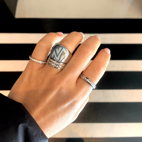Model wearing the wraparound ring, Forever ring in Silver, Just Ring and Square Zirconia Doble ring in all silver.