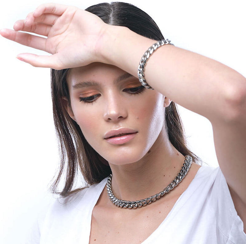 Model wearing the Palma Necklace which is a thick chain made of Rhodium plated Stainless steel with box lock and the Palma chain bracelet.