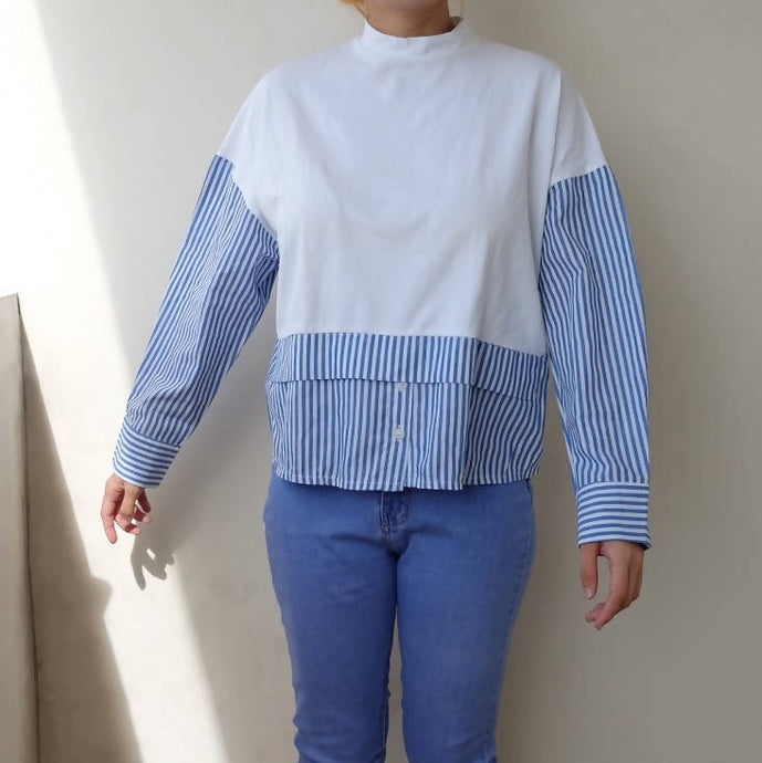 White and blue long sleeved top
