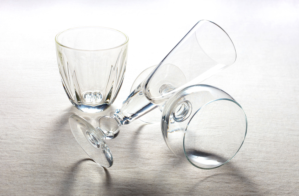 a tumbler, a champagne flute and a stem wine glass