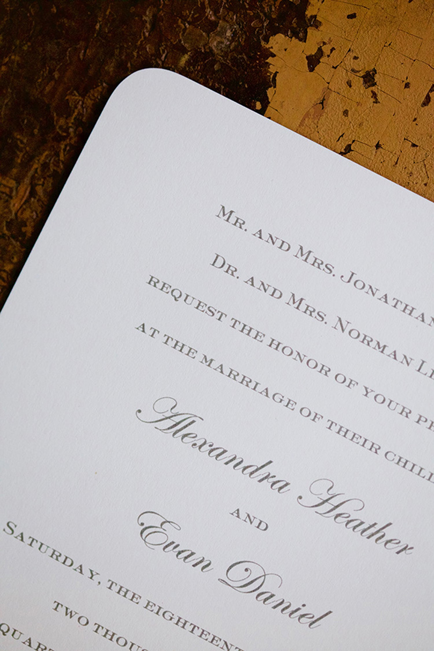 Alex & Evan is an engraved wedding suite set in NYC. Empire size natural white classic crest double thick paper in pewter ink with rounded corners and navy edge painting. Call us toll-free at 1-800-995-1549 or email us at hello@pickettspress.com