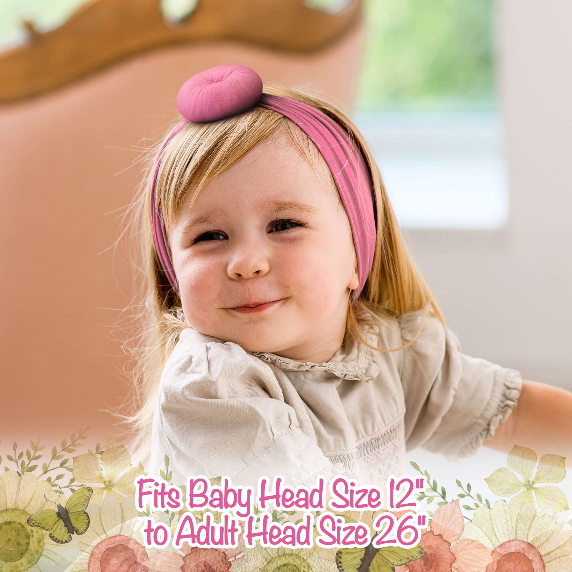 a little girl with a pink hat on her head