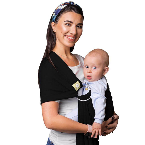 a woman is holding a baby in her arms