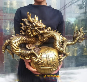 Golden Dragon Holding The World Bronze Statue