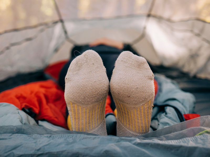 feet sticking out of a tent