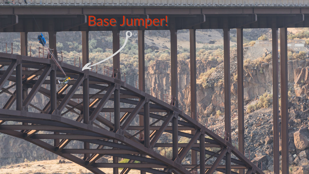 a base jumper opens his chute after jumping off of perrine bridge