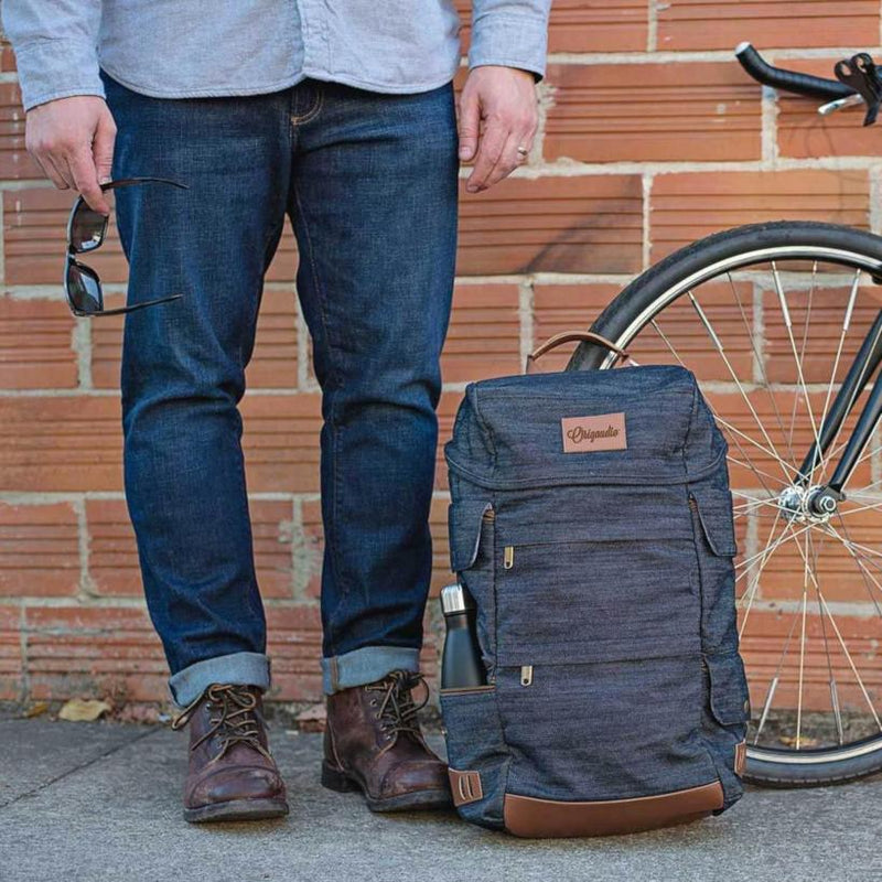 The Denim Presidio Pack sits between a man and his bike.