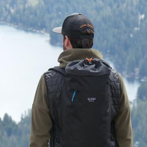 A man wears the Crag Pack.