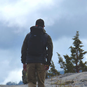 A man wears the Crag Pack hiking.