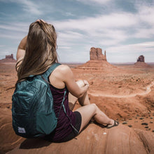 Load image into Gallery viewer, A woman wears the DL16 Backpack at Red Rocks.
