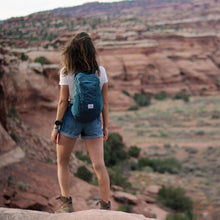 Load image into Gallery viewer, A woman wears the DL16 Backpack.