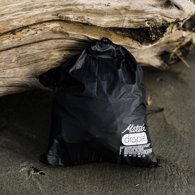 Matador Droplet Wet Bag--Black--on beach
