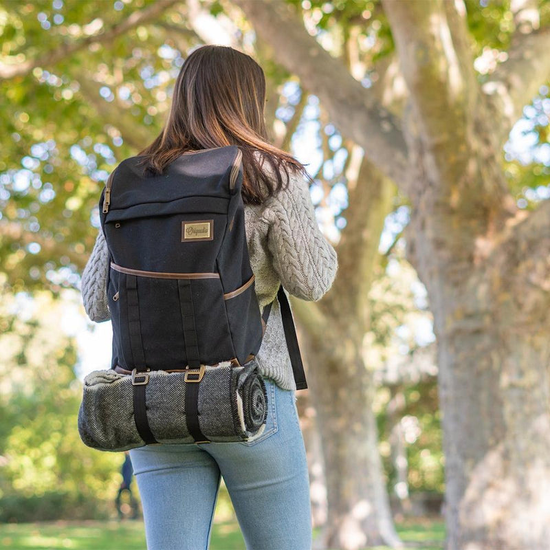 A woman carries the Black Finley Mill Pack