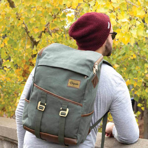 Man in a beanie uses the Green Finley Mill Pack.