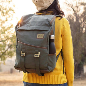 A woman carries Green Finley Mill Pack