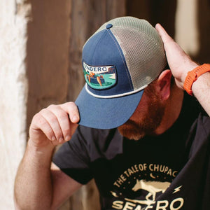 man putting on a sendero provisions co rio hat