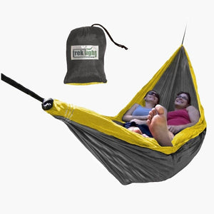two women relaxing in a hammock
