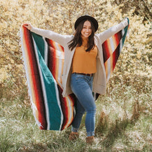 Load image into Gallery viewer, woman smiling while holding monterey blanket in outstretched arms