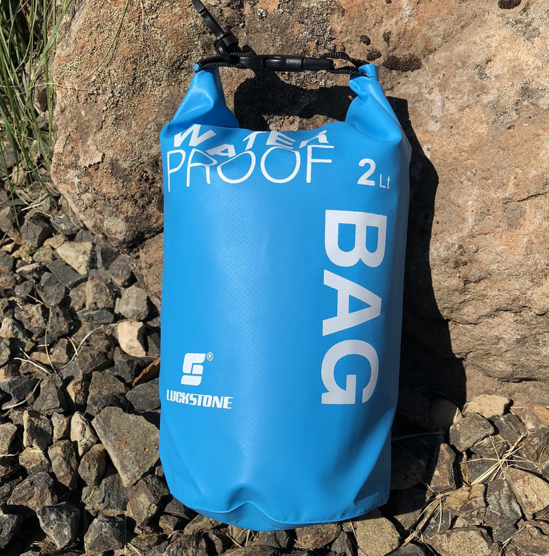 Waterproof Dry Bag--Blue on rocks