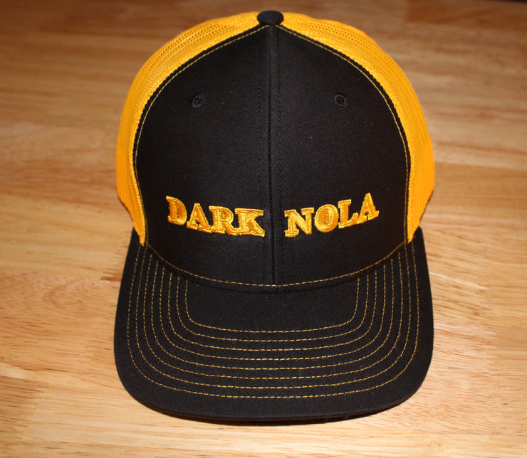 yellow and black trucker snap-back, with embroidered dark nola logo