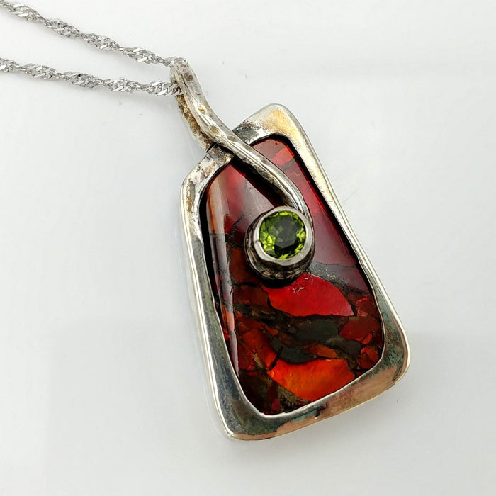 Ammolite Pendant - Red Ammolite with Peridot by Linda Zepik
