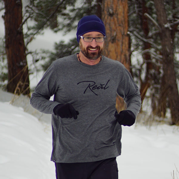 The heather grey of the Men's Long Sleeve Blue Ridge shirt suggests comfort. The Poly/Lycra/Tencel blended fabric delivers the comfort. You can wear this shirt during your run, before your workout or race. It is best worn while making the walk up to the podium afterwards.