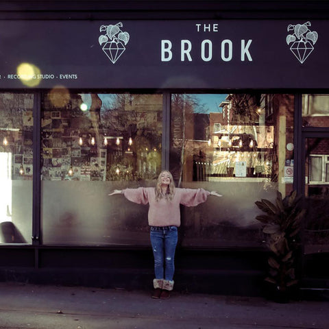 Thea in front of The Brook restaurant