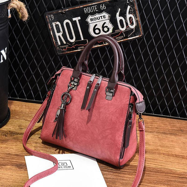 Trendinggate.com 2018New style retro handbag ladies'bag with one shoulder and inclined shoulder style tassels fashion middle-aged bag with one hair substitute