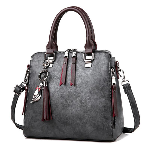 Trendinggate.com Dark grey 2018New style retro handbag ladies'bag with one shoulder and inclined shoulder style tassels fashion middle-aged bag with one hair substitute