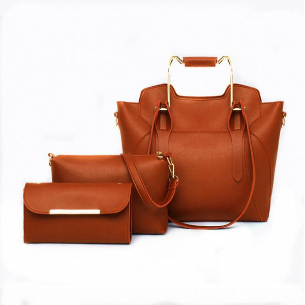 Trendinggate.com 2019New European and American fashion solid color hand bill of lading shoulder slung large capacity three-piece condom mother bag women bag