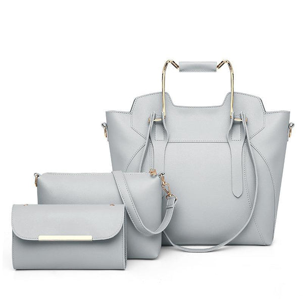 Trendinggate.com Light grey 2019New European and American fashion solid color hand bill of lading shoulder slung large capacity three-piece condom mother bag women bag